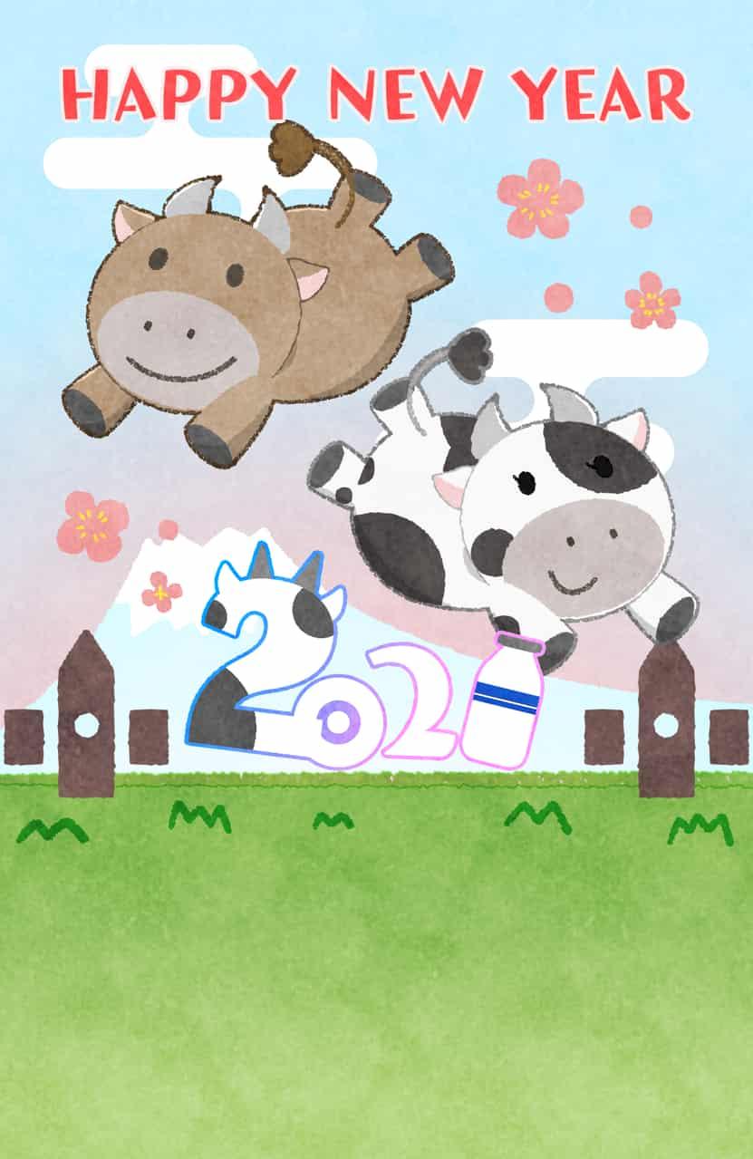 草地を駆ける牛の年賀状